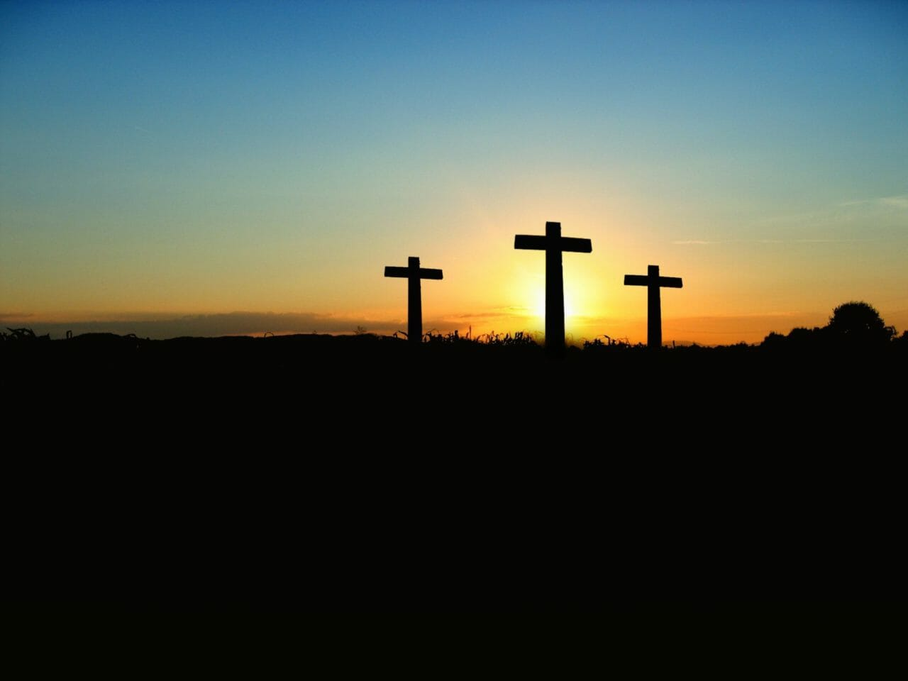 crosses at sunset on mountain