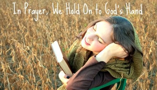 In Prayer, We Hold On to God's Hand