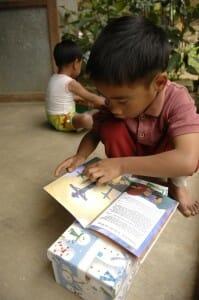 Child Reading Gospel Booklet