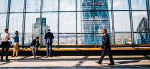 Important Gentleman walking through a skyscraper