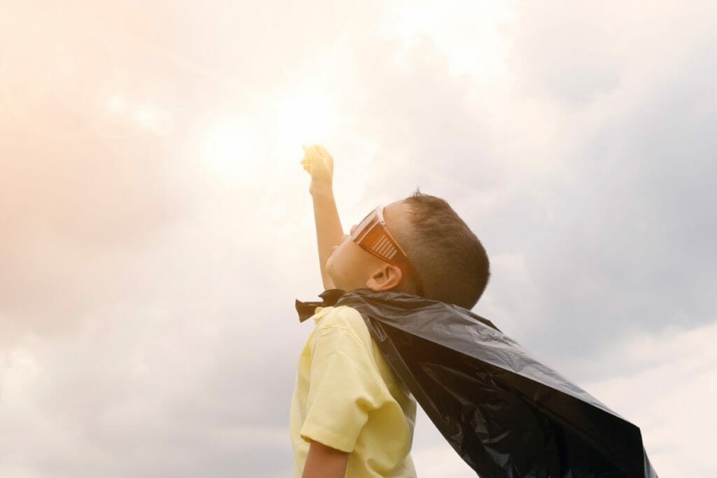 boy with cape and sunglasses