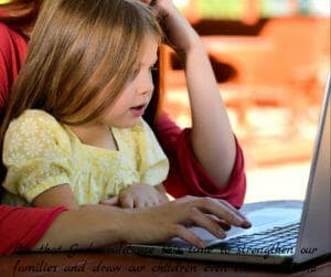 young girl with mom on laptop computer