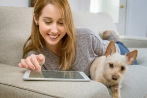 teenage daughter on tablet with dog