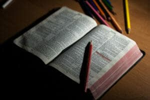 Bible & colored pencils sitting on a table