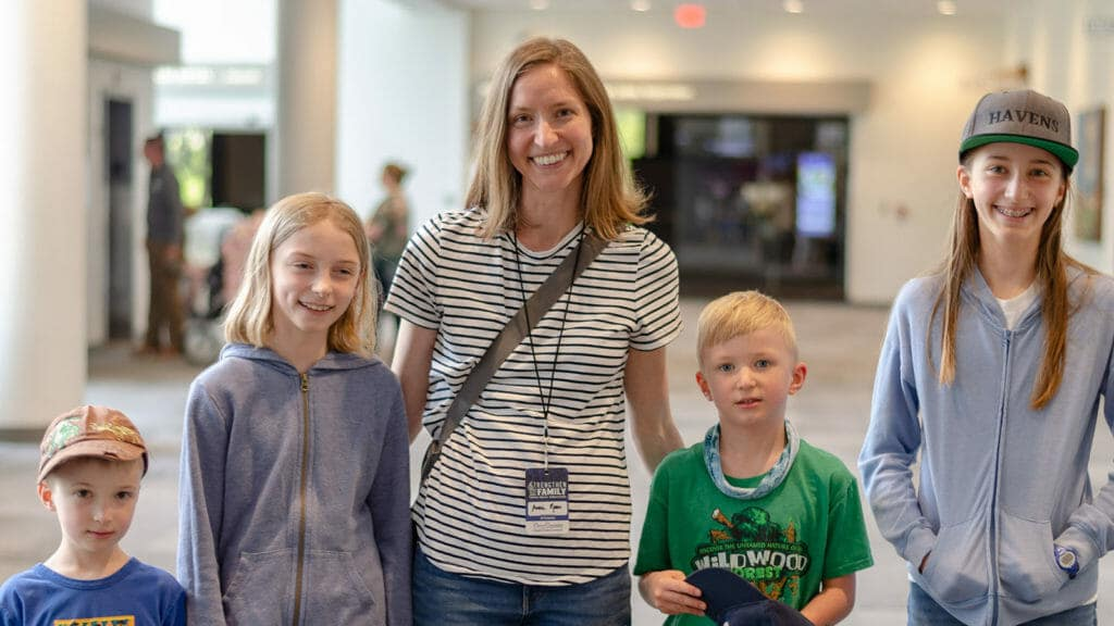 Smiling Homeschool Family at Teach Them Diligently Convention