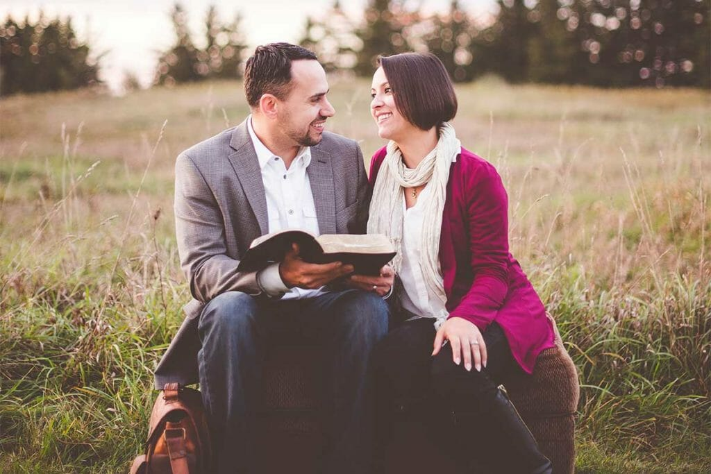Married couple reading the Bible together