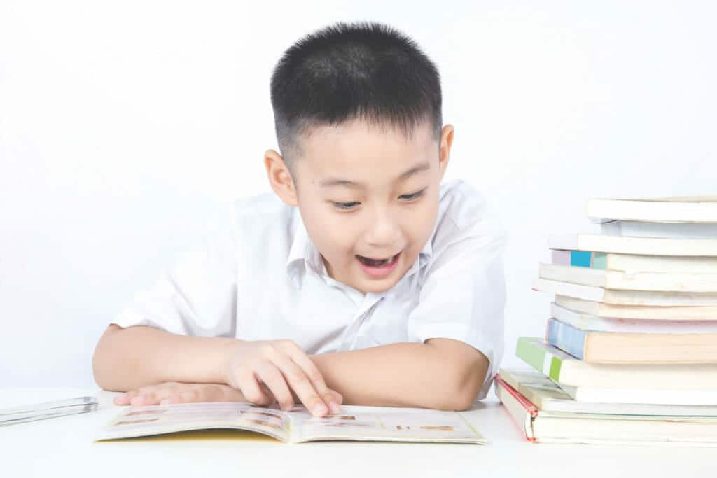 Little boy excited about something he read in a book