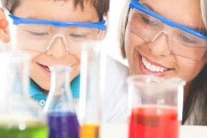 Mother & son doing a chemistry lab together