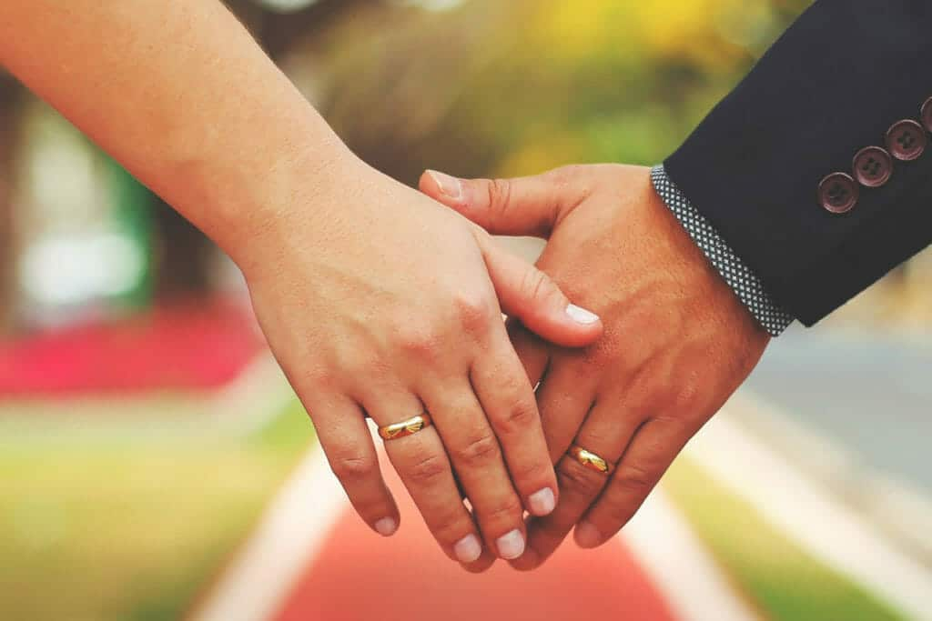 Married couple's hands with rings