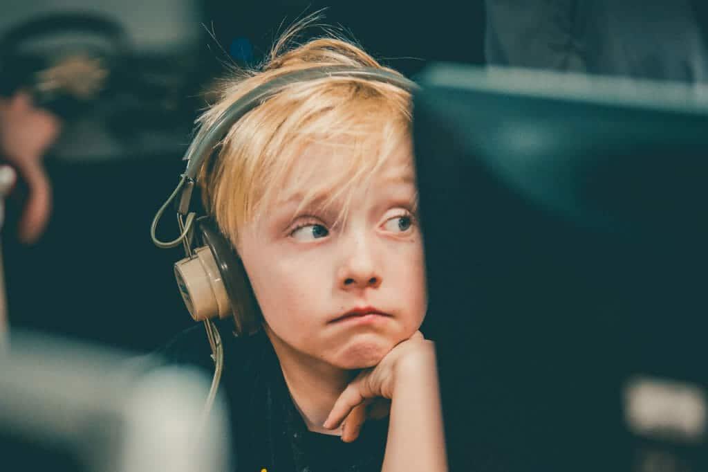 Boy at computer wearing headphones