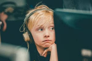 Boy at computer wearing headphones