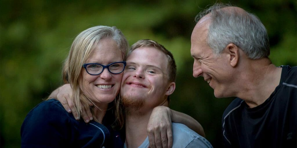 Special Needs son with his parents