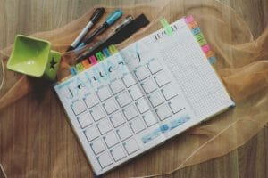 Cute monthly planner with colored pens