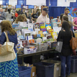 Homeschool parents browsing the resource fair at the Teach Them Diligently convention