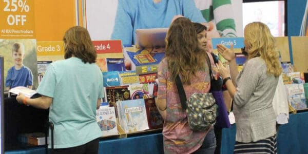 Families visiting exhibitor booths at the Teach Them Diligently homeschool convention